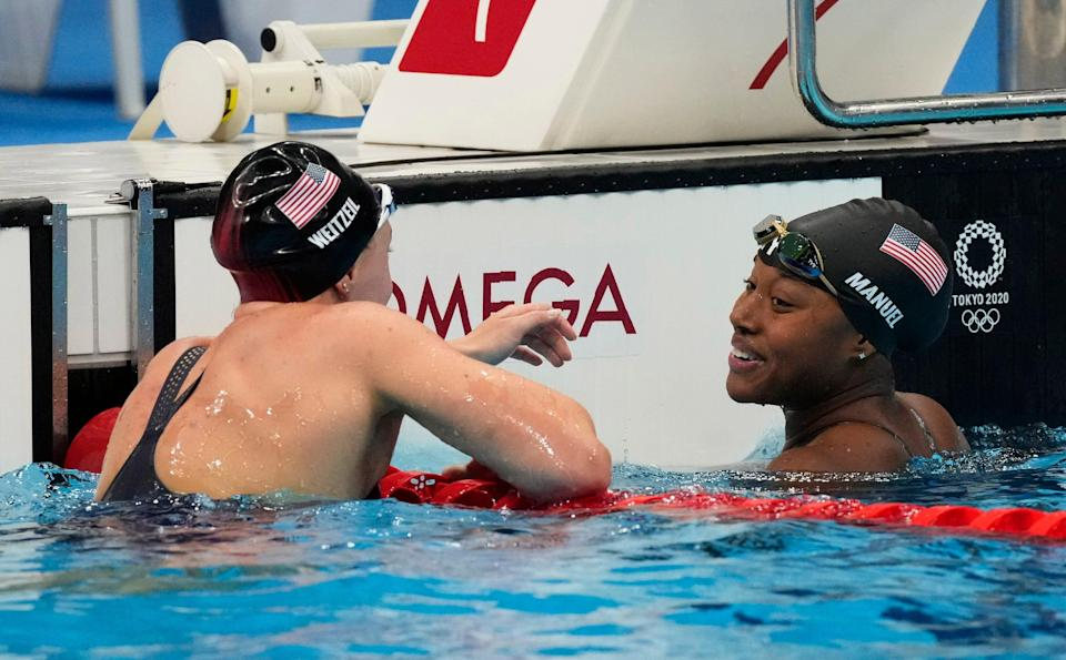 Simone Manuel and Abbey Weitzeil react after the women's 50m freestyle semifinals during the Tokyo 2020 Olympic Summer Games.