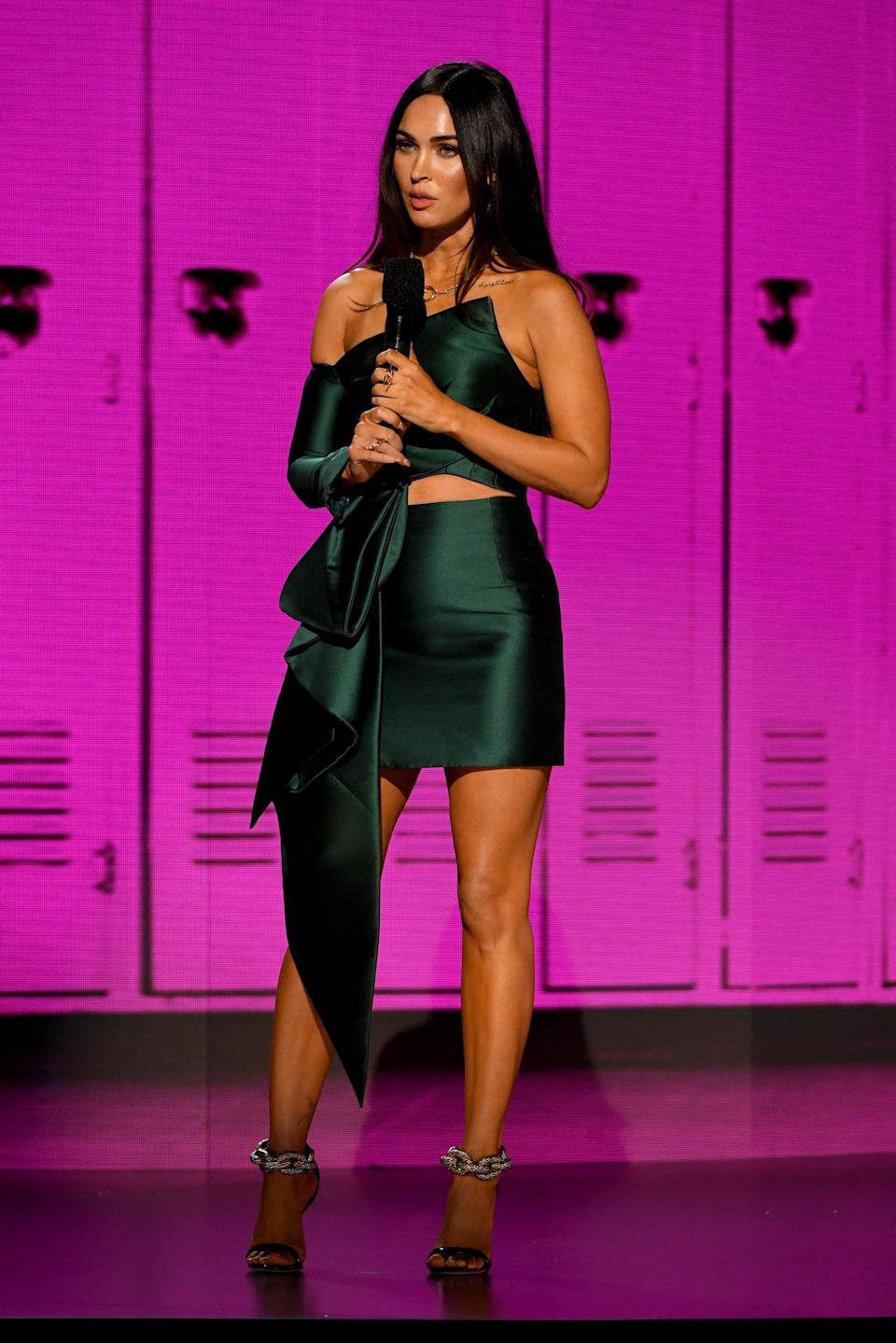 <p>Megan presented at the 2020 American Music Awards in a statement emerald Azzi &amp; Osta set. </p>