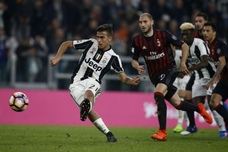 Juventus' forward Paulo Dybala from Argentina scores a penalty during the Italian Serie A football match Juventus Vs AC Milan on March 10, 2017 at the 'Juventus Stadium' in Turin