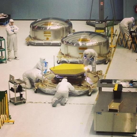 One of the last three flight primary mirror segments of the James Webb Space Telescope are inspected after delivery to NASA Goddard.