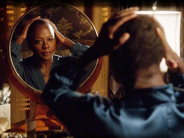 """<p>Viola Davis' character in How To Get Away With Murder is a badass in every which way, but we especially love the moment when - before confronting her cheating husband with his infidelities -she sits in front of her vanity, and takes off her wig, falsies, and lipstick. The moment was described by The Cut as <a href=""""https://www.thecut.com/2016/10/viola-davis-her-wig-and-a-great-moment-in-tv-history.html"""" target=""""_blank"""" class=""""ga-track"""" data-ga-category=""""Related"""" data-ga-label=""""https://www.thecut.com/2016/10/viola-davis-her-wig-and-a-great-moment-in-tv-history.html"""" data-ga-action=""""In-Line Links"""">The Single Greatest Moment in Black-Women Television History</a> and we agree: it was, as one editor put it, """"epic."""" </p>"""