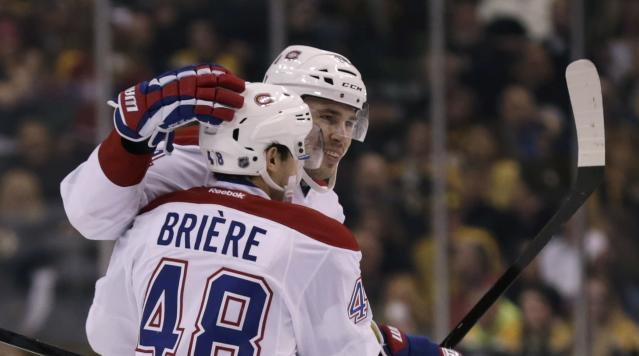 Montreal Canadiens defenseman Alexei Emelin, rear, is congratulated by teammate Daniel Briere after his goal during the first period of an NHL hockey game, Monday, March 24, 2014, in Boston. (AP Photo/Charles Krupa)