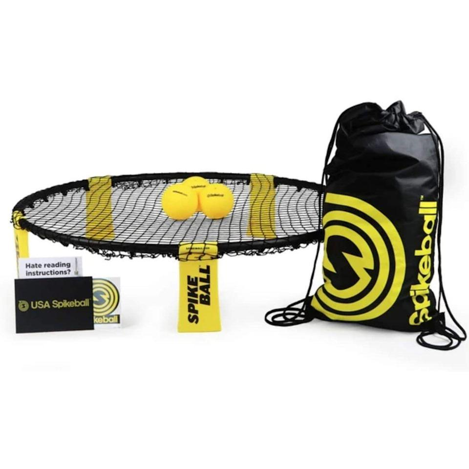 """<p><strong>Spikeball</strong></p><p>amazon.com</p><p><strong>$59.95</strong></p><p><a href=""""https://www.amazon.com/dp/B002V7A7MQ?tag=syn-yahoo-20&ascsubtag=%5Bartid%7C2141.g.27760489%5Bsrc%7Cyahoo-us"""" rel=""""nofollow noopener"""" target=""""_blank"""" data-ylk=""""slk:Shop Now"""" class=""""link rapid-noclick-resp"""">Shop Now</a></p><p>Take him back to his college days with this high-energy lawn game, which is <em>way</em> better than anything he played on the quad. Spikeball is easy to learn and transports anywhere, including the park and the beach—and he'll appreciate the extra exercise, too.</p>"""