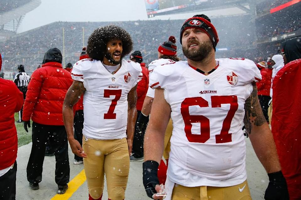 Colin Kaepernick #7 of the San Francisco 49ers, pictured during a match in December 2016, began kneeling during the national anthem to protest police brutality and racial injustice (AFP Photo/Joe Robbins)