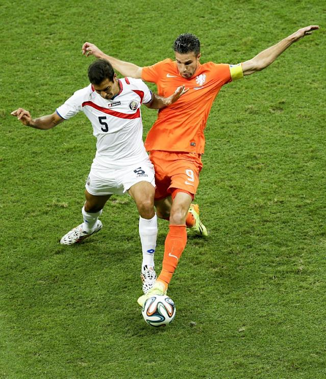Costa Rica's Celso Borges, left, and Netherlands' Robin van Persie go for the ball during the World Cup quarterfinal soccer match between the Netherlands and Costa Rica at the Arena Fonte Nova in Salvador, Brazil, Saturday, July 5, 2014. (AP Photo/Themba Hadebe)
