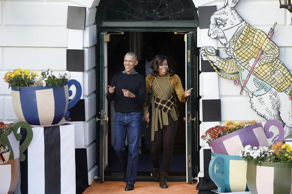"""<p>What were POTUS and FLOTUS's Halloween costumes for their final holiday in the White House? Themselves as regular citizens (well, best guess anyways). With President Barack Obama in his dad uniform consisting of jeans and a sweater, Michelle Obama, on the other hand, dressed as a fashionista in a 3.1 Phillip Lim top with black pants and black boots. The asymmetric velvet-trimmed wool-jacquard sweater <a rel=""""nofollow noopener"""" href=""""https://www.net-a-porter.com/us/en/product/750534/31_Phillip_Lim/asymmetric-velvet-trimmed-wool-jacquard-sweater"""" target=""""_blank"""" data-ylk=""""slk:retails for $65"""" class=""""link rapid-noclick-resp"""">retails for $65</a>0 and """"reinterprets the artistry of Japanese armor in a decidedly modern way."""" <i>(Photo: AP)</i></p>"""