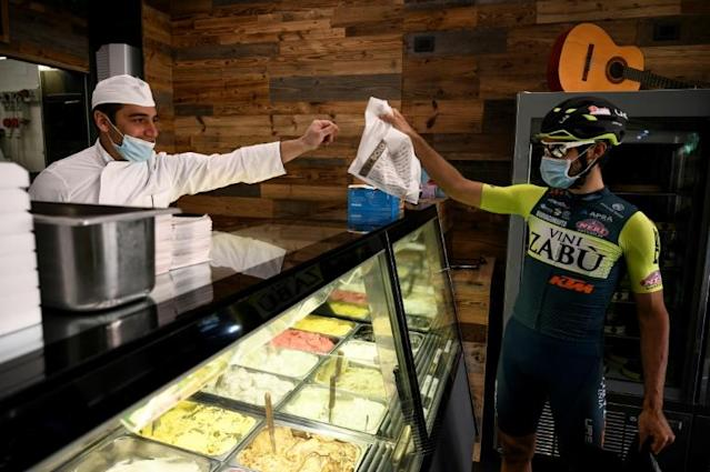 Professional cyclist Umberto Marengo was supposed to be training for the Giro d'Italia, but now he's delivering ice cream (AFP Photo/MARCO BERTORELLO)