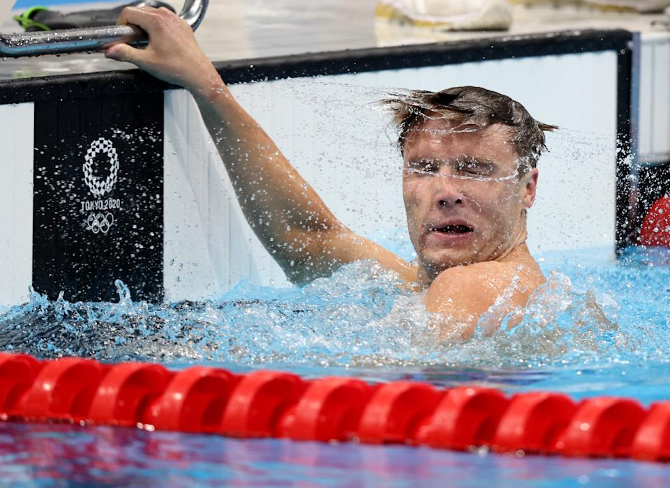 <p>Robert Finke of Team United States reacts after winning the gold medal in the Men's 800m Freestyle Final on day six of the Tokyo 2020 Olympic Games at Tokyo Aquatics Centre on July 29, 2021 in Tokyo, Japan. (Photo by Tom Pennington/Getty Images)</p>