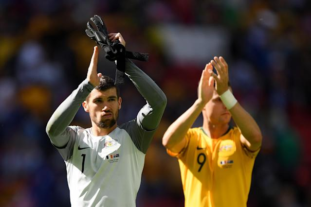 <p>The Australia players take the applause at full-time </p>