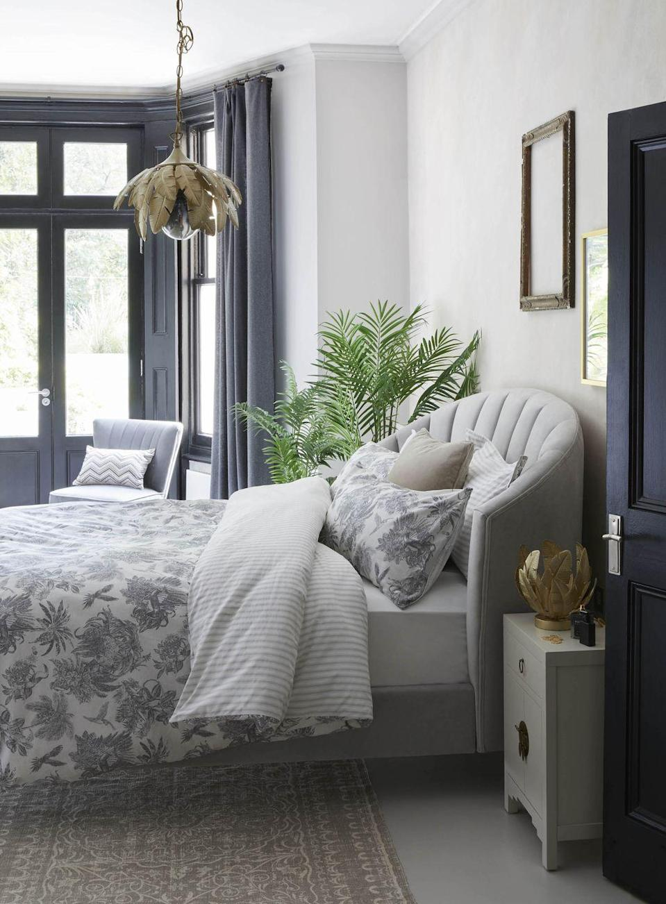 """<p>If you want a grey bedroom scheme but you think dark walls aren't for you, why not paint the door and window frames to add a 'frame' to the room and a backdrop to the furniture? Your eye is drawn to it as soon as you walk in the room. Then add plain grey curtains that seem to disappear when they are open, attached to a black pole.</p><p>Pictured: Farrah Palm Leaf Ceiling Fitting Gold, Matilda Dove Grey Bed, Amazonia Toile Duvet Cover Set, Farrah Palm Leaf Touch Table Lamp, Hannah Mini Oyster Chest, Medallion Cotton Rug, Grey Isla Chair, all <a href=""""https://go.redirectingat.com?id=127X1599956&url=https%3A%2F%2Fwww.dunelm.com%2F&sref=https%3A%2F%2Fwww.housebeautiful.com%2Fuk%2Fdecorate%2Fbedroom%2Fg35432015%2Fgrey-bedroom-ideas%2F"""" rel=""""nofollow noopener"""" target=""""_blank"""" data-ylk=""""slk:Dunelm"""" class=""""link rapid-noclick-resp"""">Dunelm</a></p>"""