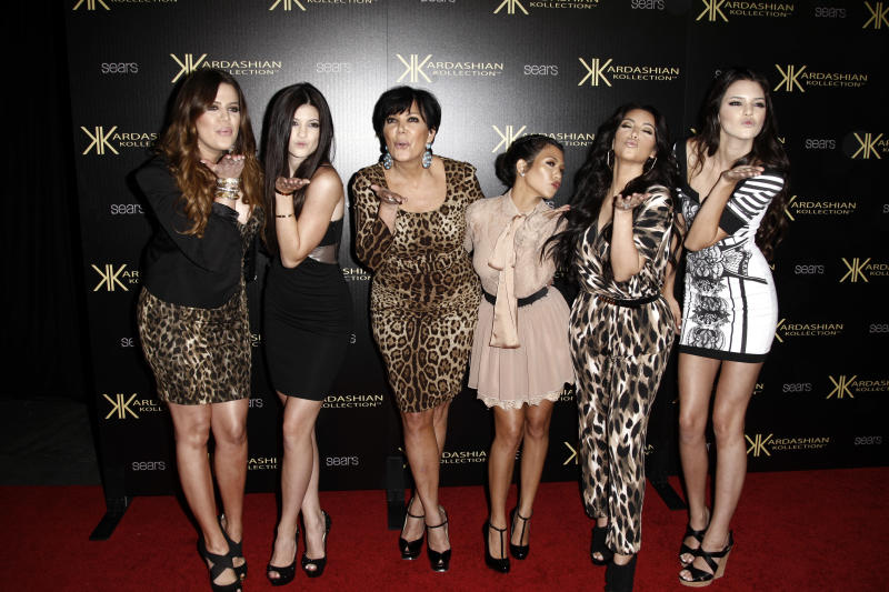 From left, Khloe Kardashian, Kylie Jenner, Kris Jenner, Kourtney Kardashian, Kim Kardashian, Kendall Jenner arrives at the Kardashian Kollection launch party in Los Angeles, Wednesday, Aug. 17, 2011. The Kardashian Kollection designed by the Kardashian sisters is available at Sears. (AP Photo/Matt Sayles)