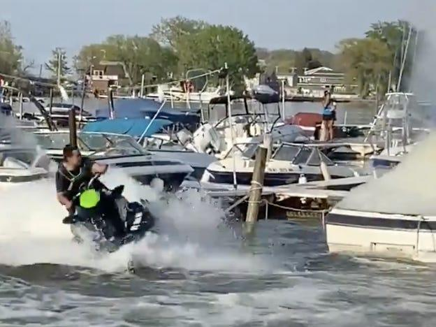 Firefighter douses boat fire