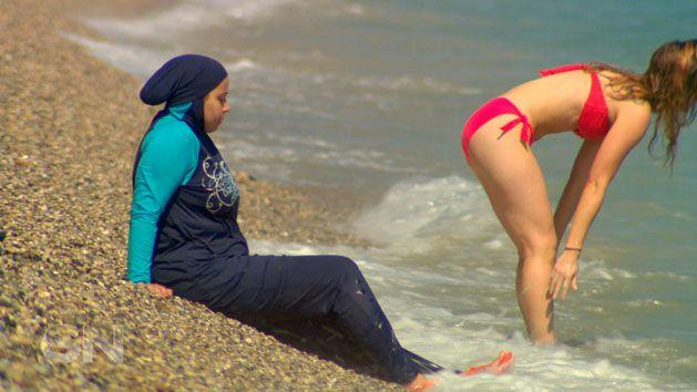 The stark contrast between the burkini, designed in Australia, and bikini which originated in France