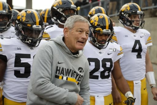 Iowa head coach Kirk Ferentz leads his team on the field before an NCAA college football game against Wisconsin Saturday, Nov. 9, 2019, in Madison, Wis. (AP Photo/Morry Gash)