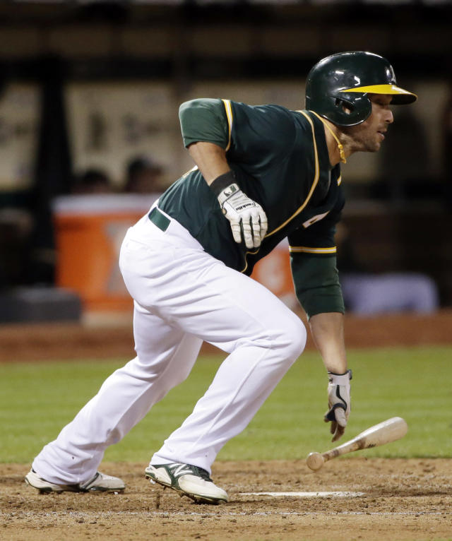 Oakland Athletics' Sam Fuld drives in a run with a triple against the Los Angeles Angels during the sixth inning of a baseball game Friday, Aug. 22, 2014, in Oakland, Calif. (AP Photo/Marcio Jose Sanchez)