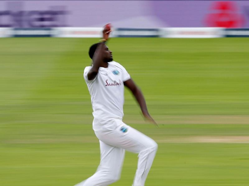 Jason Holder in full flight for the West Indies: POOL/AFP via Getty Images