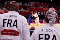 <p>France's Teddy Riner (L) and France's Romane Dicko (R) attend the bout between France's Margaux Pinot (C, R) and Israel's Gili Sharir (blue) during the judo mixed team's quarterfinal during the Tokyo 2020 Olympic Games at the Nippon Budokan in Tokyo on July 31, 2021. (Photo by Jack GUEZ / AFP)</p>