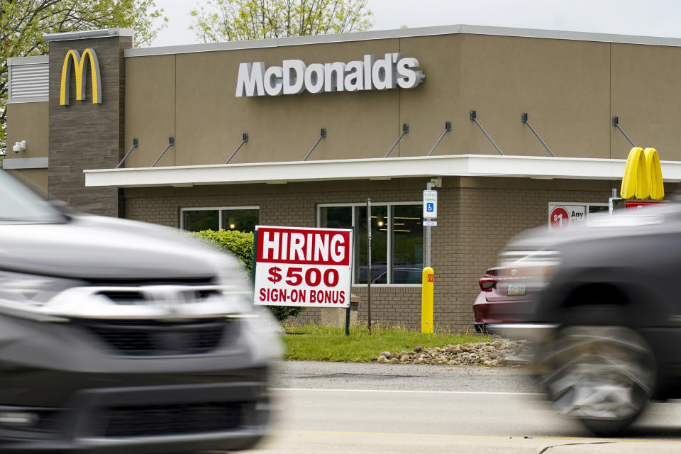 A hiring sign offers a $500 bonus outside a McDonald's restaurant, in Cranberry Township, Butler County, Pa., Wednesday, May 5, 2021. A bill by Pennsylvania's Republican-controlled Legislature to reinstate work-search requirements for people claiming unemployment benefits cleared the House Labor and Industry Committee on a party-line vote Tuesday. The sponsor, Rep. Jim Cox of Berks County, said many employers are having trouble finding workers. (AP Photo/Keith Srakocic)