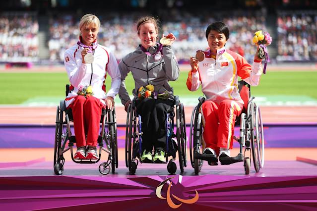 LONDON, ENGLAND - SEPTEMBER 06: (L-R) Silver medallist Edith Wolf of Switzerland, gold medallist Tatyana Mcfadden of the United States and bronze medallist Lihong Zou of China pose on the podium during the medal ceremony for the Women's 800m T54 Final on day 8 of the London 2012 Paralympic Games at Olympic Stadium on September 6, 2012 in London, England. (Photo by Julian Finney/Getty Images)