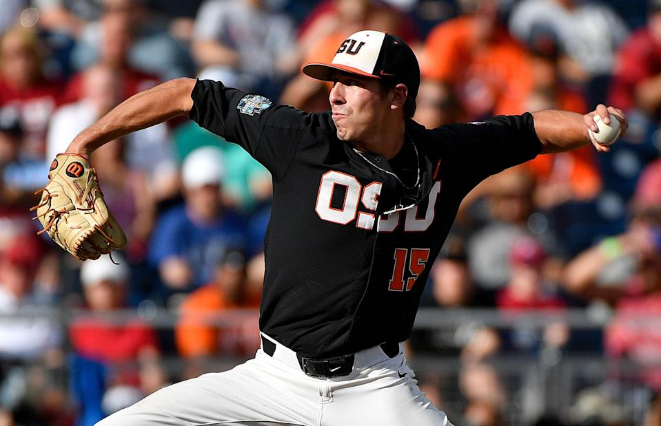 Oregon State pitcher Luke Heimlich throws against Arkansas during the first inning of Game 1 of the NCAA College World Series baseball finals in Omaha, Neb., Tuesday, June 26, 2018. (AP Photo/Ted Kirk)