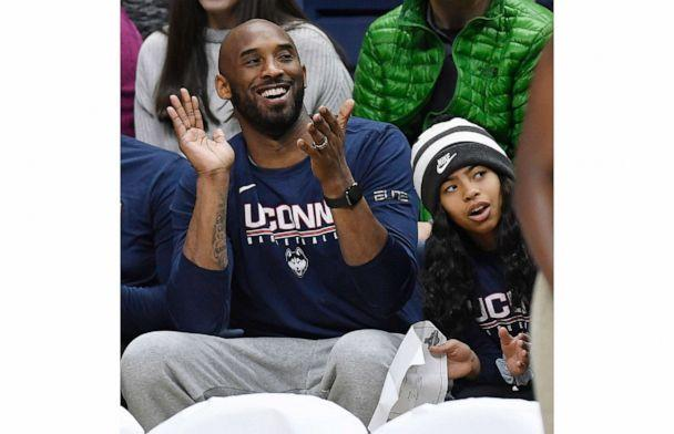 PHOTO: In this March 2, 2019, photo, Kobe Bryant and his daughter, Gianna, watch the first half of an NCAA college basketball game between Connecticut and Houston in Storrs, Conn. (Jessica Hill/AP, File)