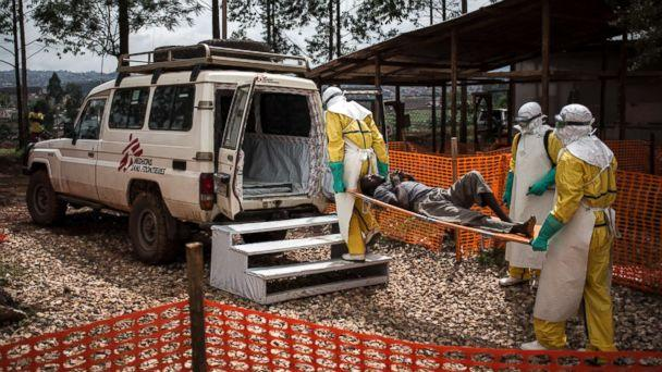 PHOTO: Health workers move a patient to a hospital after he was cleared of having Ebola inside of a Medecins Sans Frontieres supported Ebola treatment center in Butembo, Congo, Nov. 4, 2018. (John Wessels/MSF via AP)
