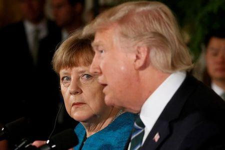 Merkel and Trump hold a joint news conference in the East Room of the White House in Washington