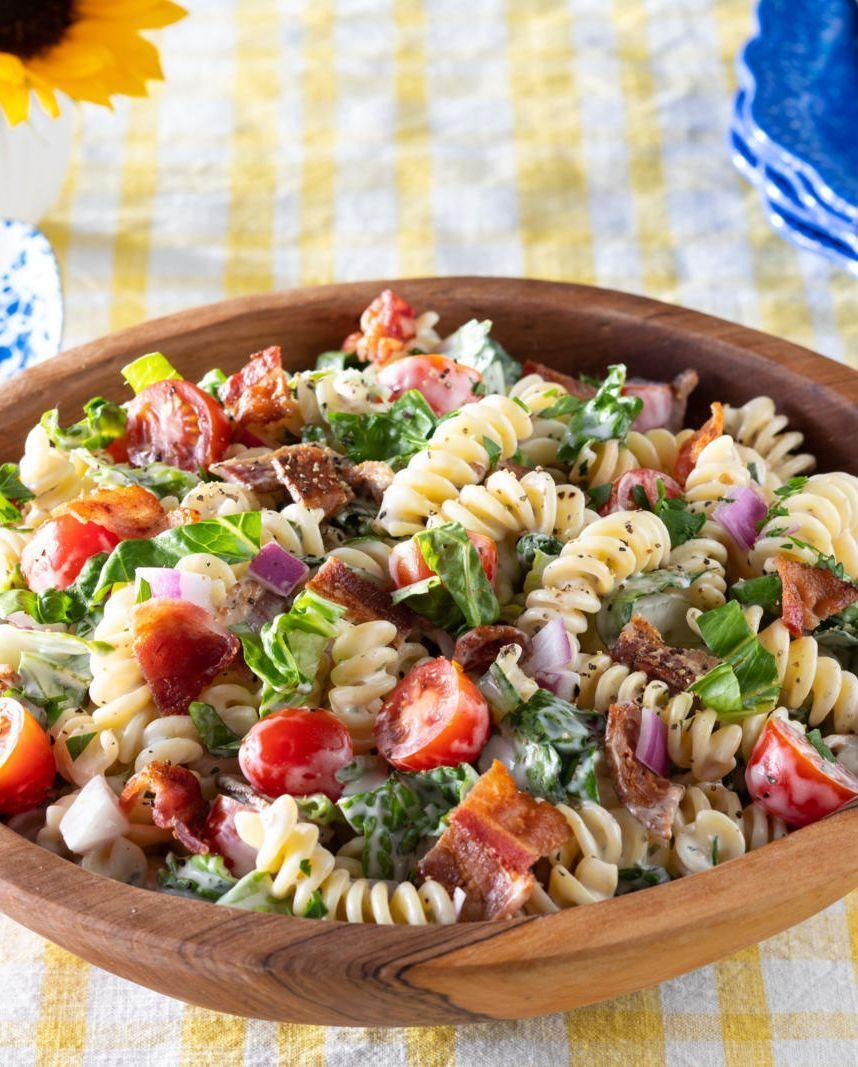"""<p>The sandwich you love so much transforms into a pasta dish with this easy summer recipe. </p><p><strong><a href=""""https://www.thepioneerwoman.com/food-cooking/recipes/a36068261/blt-pasta-salad-recipe/"""" rel=""""nofollow noopener"""" target=""""_blank"""" data-ylk=""""slk:Get the recipe"""" class=""""link rapid-noclick-resp"""">Get the recipe</a>.</strong></p><p><a class=""""link rapid-noclick-resp"""" href=""""https://go.redirectingat.com?id=74968X1596630&url=https%3A%2F%2Fwww.walmart.com%2Fbrowse%2Fhome%2Fserveware%2Fthe-pioneer-woman%2F4044_623679_639999_2347672&sref=https%3A%2F%2Fwww.thepioneerwoman.com%2Ffood-cooking%2Fmeals-menus%2Fg32157273%2Ffourth-of-july-appetizers%2F"""" rel=""""nofollow noopener"""" target=""""_blank"""" data-ylk=""""slk:SHOP SERVING BOWLS"""">SHOP SERVING BOWLS</a></p>"""