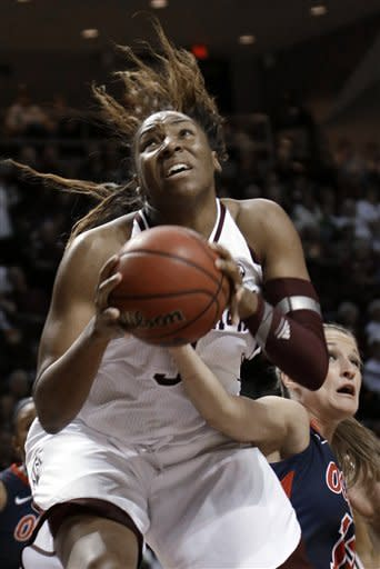 Mississippi's Gracie Frizzell, right, tries to reach around Texas A&M 's Kelsey Bone, front, for the ball during the first half of an NCAA college basketball game Thursday, Feb. 21, 2013, in College Station, Texas. (AP Photo/Pat Sullivan)