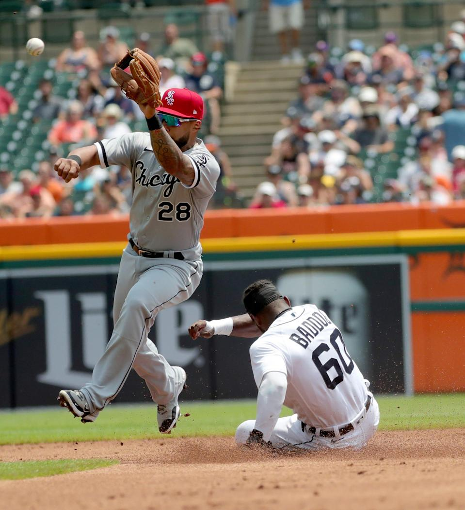 Detroit Tigers left fielder Akil Baddoo slides safely into second base ahead of the tag by Chicago White Sox second baseman Leury Garcia in the first inning at Comerica Park in Detroit, Sunday, July 4, 2021.