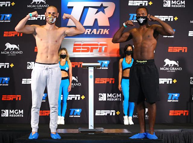 The manager of lightweight Mikkel LesPierre (R) tested positive for COVID-19 on Wednesday, forcing the cancellation of his bout against Jose Pedraza, which had been slated to be the main event of an ESPN card tonight in Las Vegas. (Mikey Williams/Top Rank)