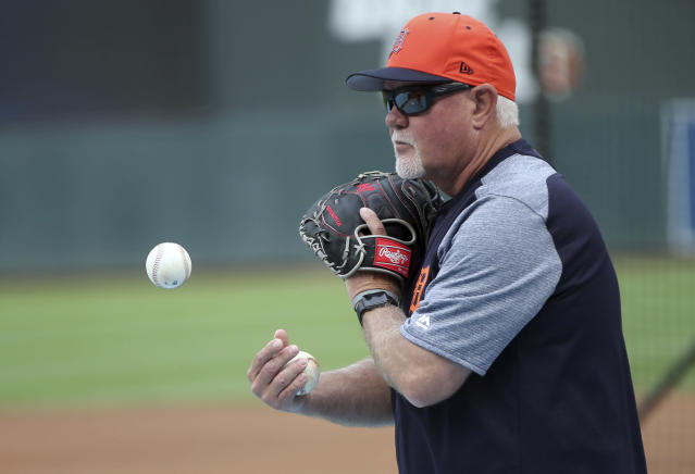 Detroit Tigers manager Ron Gardenhire tosses the ball to a coach hitting fly balls during practice before the Tigers' baseball game against the Minnesota Twins Monday, May 21, 2018, in Minneapolis. Gardenhire is going against his former team, the Minnesota Twins, as a manager for the first time as the Detroit Tigers start a three-game series at Target Field. Gardenhire spent 13 seasons managing the Twins. (AP Photo/Jim Mone)