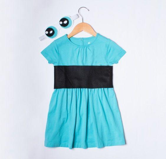 """<p>Have a little one obsessed with the <em>Powerpuff Girls</em> character Bubbles? You can put this DIY together in no time with the help of a simple blue T-shirt dress and some felt fabric. Tip: Attach the black felt belt with removable adhesive tape so your child can sport the dress again once the holiday is over. </p><p><strong>Get the tutorial at <a href=""""https://go.redirectingat.com?id=74968X1596630&url=https%3A%2F%2Fwww.primary.com%2Fdiy%2Fall%2Fpower-puff-girl&sref=https%3A%2F%2Fwww.countryliving.com%2Fdiy-crafts%2Fg29344983%2Fpowerpuff-girls-costumes%2F"""" rel=""""nofollow noopener"""" target=""""_blank"""" data-ylk=""""slk:Primary"""" class=""""link rapid-noclick-resp"""">Primary</a>. </strong> </p>"""