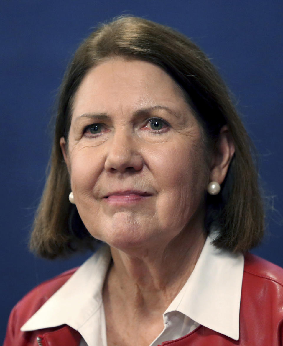 FILE - In this Oct. 9, 2018, file photo, then-candidate for Congressional District 2, Democrat Ann Kirkpatrick, of Arizona, talks with members of the media following a debate with Republican Lea Marquez Peterson in Tucson, Ariz. Kirkpatrick, a five-term Arizona Democrat, announced Friday, March 12, 2021, she won't run for reelection in 2022 (Kelly Presnell/Arizona Daily Star via AP)
