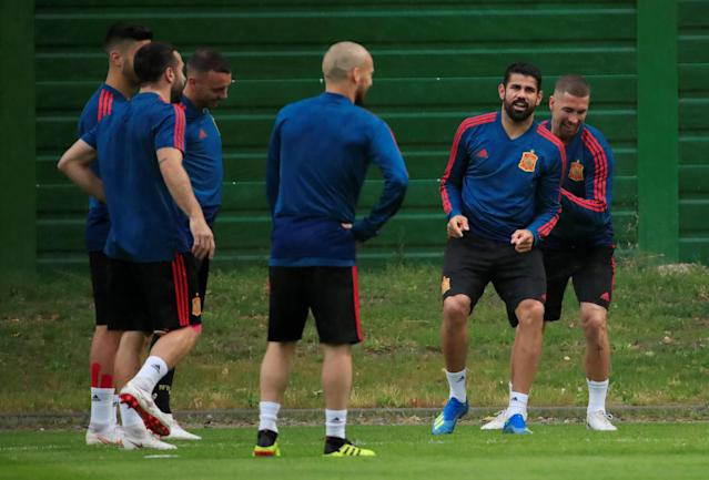 Soccer Football - World Cup - Spain Training - Spain Training Camp, Kaliningrad, Russia - June 24, 2018 Spain's Diego Costa, Sergio Ramos and team mates during training REUTERS/Gonzalo Fuentes