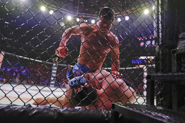 Lyoto Machida (above) punches Chael Sonnen at Bellator 222 in New York. Machida stopped Sonnen in the second round. (AP Photo/Frank Franklin II)