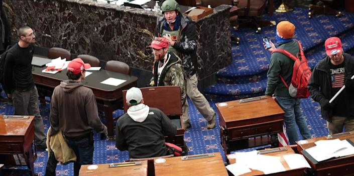Protesters enter the Senate Chamber on January 06, 2021 in Washington, DC. Congress held a joint session today to ratify President-elect Joe Biden's 306-232 Electoral College win over President Donald Trump. Pro-Trump protesters have entered the U.S. Capitol building after mass demonstrations in the nation's capital.