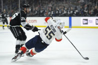 Florida Panthers center Noel Acciari, right, falls as he shoots the puck while under pressure from Los Angeles Kings defenseman Sean Walker during the first period of an NHL hockey game Thursday, Feb. 20, 2020, in Los Angeles. (AP Photo/Mark J. Terrill)