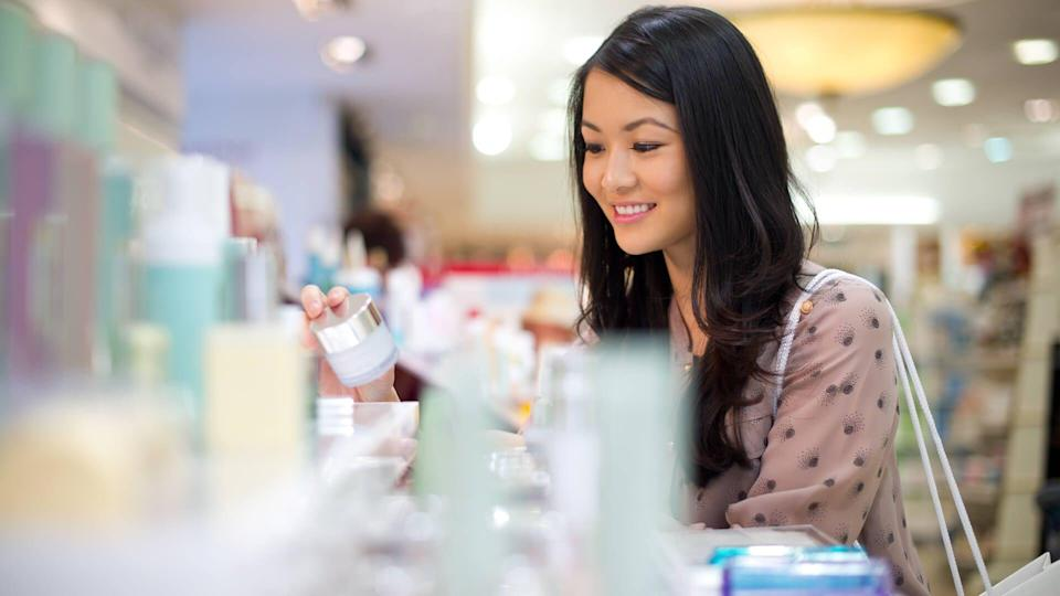 young woman shopping for make up.