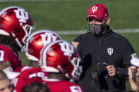 FILE - In this Saturday, Nov. 7, 2020, file photo, Indiana head coach Tom Allen looks toward his players on the sideline during a break in the second half of an NCAA college football game against Michigan in Bloomington, Ind. Allen is coach of the year on the Associated Press All-Big Ten football team. (AP Photo/Doug McSchooler, File)