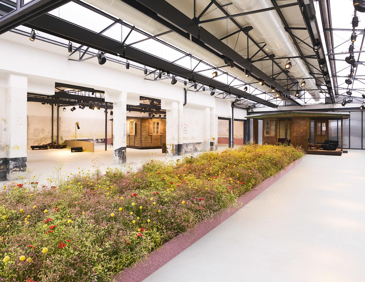 """In celebration of his new fabrics for <a href=""""https://kvadrat.dk/"""" rel=""""nofollow"""">Kvadrat</a>, Raf Simons created three installations within an installation: a trio of prefab buildings by Jean Prouvé (!), a textiles workshop showcasing the fabrics, and <em>a real flower garden leading the way</em> by florist Mark Colle. The loose, effortless display of blooms made us forget why sculpted boxwoods and perfectly trimmed rose bushes even exist. Let's go scatter some wildflower seeds in the yard (you can literally <a href=""""https://www.shopterrain.com/products/annual-wildflower-seeds-tin?color=Multi&size=Bag"""" rel=""""nofollow"""">buy a bag of them</a> for this purpose) and call it the best day ever. If you're lucky, your backyard will look remotely similar to <a href=""""https://www.pinterest.com/pin/435301120226722887/"""" rel=""""nofollow"""">Piet Oudolf's gardens</a>."""