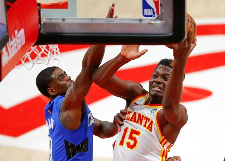 Atlanta's Clint Capela goes up for a shot as Orlando's Dwayne Bacon defends in the Hawks' 116-93 NBA victory over the Magic