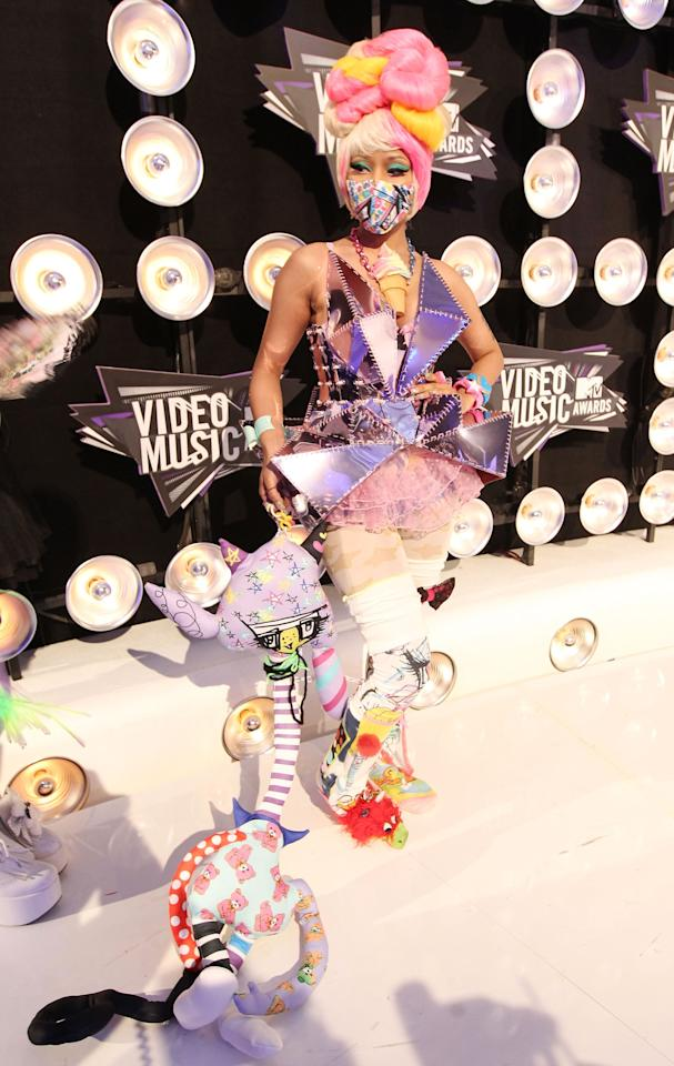 <p>Nicki had a toy chest's worth of playthings attached to her outfit at the 2011 VMAs.</p>