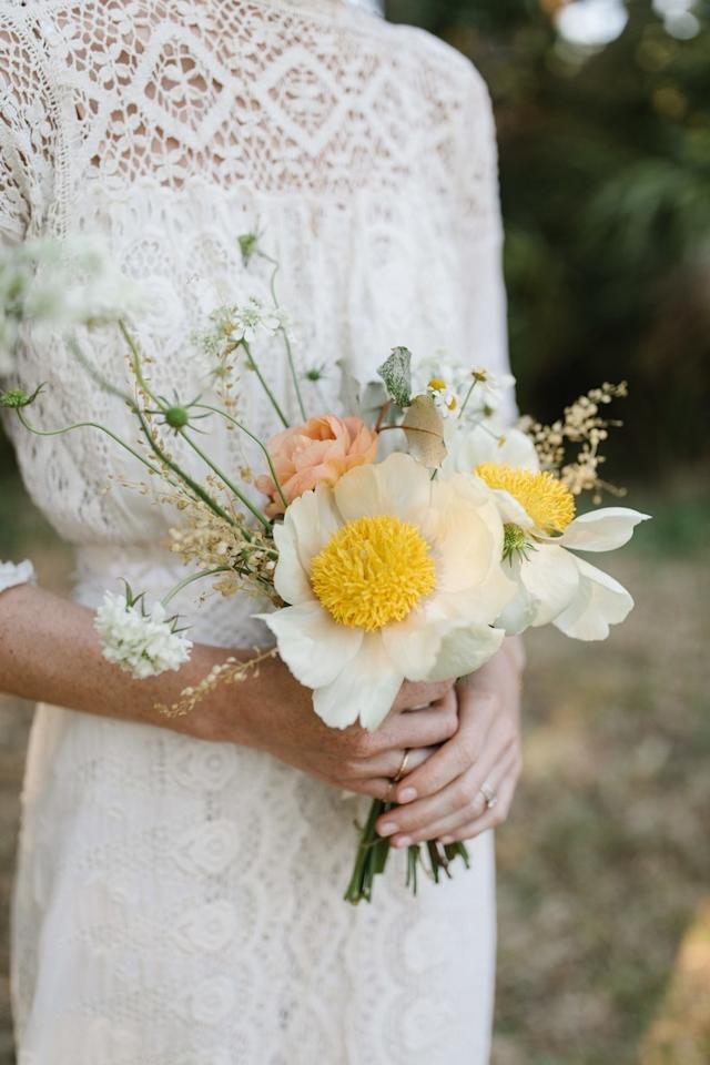 "Lily Peterson of Flowershop dreamed up this gathered bouquet of Claire de Lune peonies, coral peonies, and white daisies. ""I wanted it to be small and feel wild,"" says the bride."