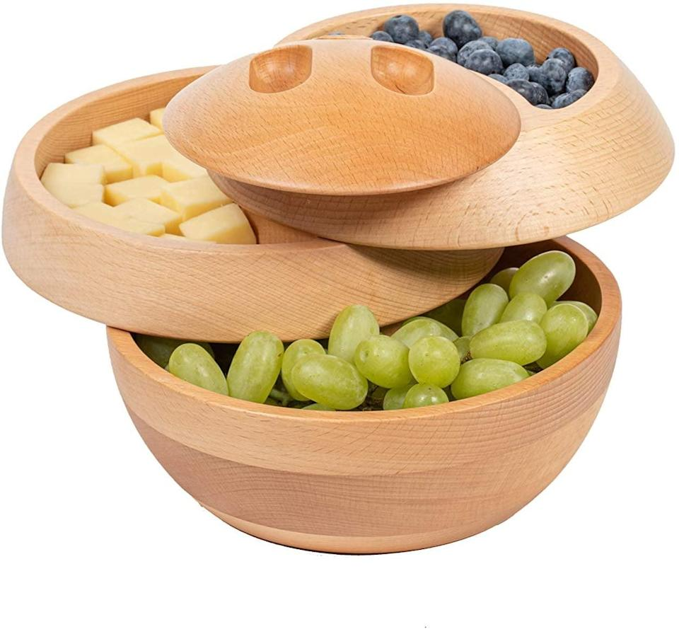 <p>Founders Sandra Portal Andreu and Juan Andreu created the one-of-a-kind <span>Tappas All Natural Wood Container</span> ($90). It's a functional serving platter that's also perfect as portable food storage and stylish table decor. It takes the traditional charcuterie board and makes it so much more functional. You can separate different foods and flavors from each other so you can keep things neat and in their place. No more having dip leak all over the place. The minimalist wood design also fits a variety of aesthetics. </p>