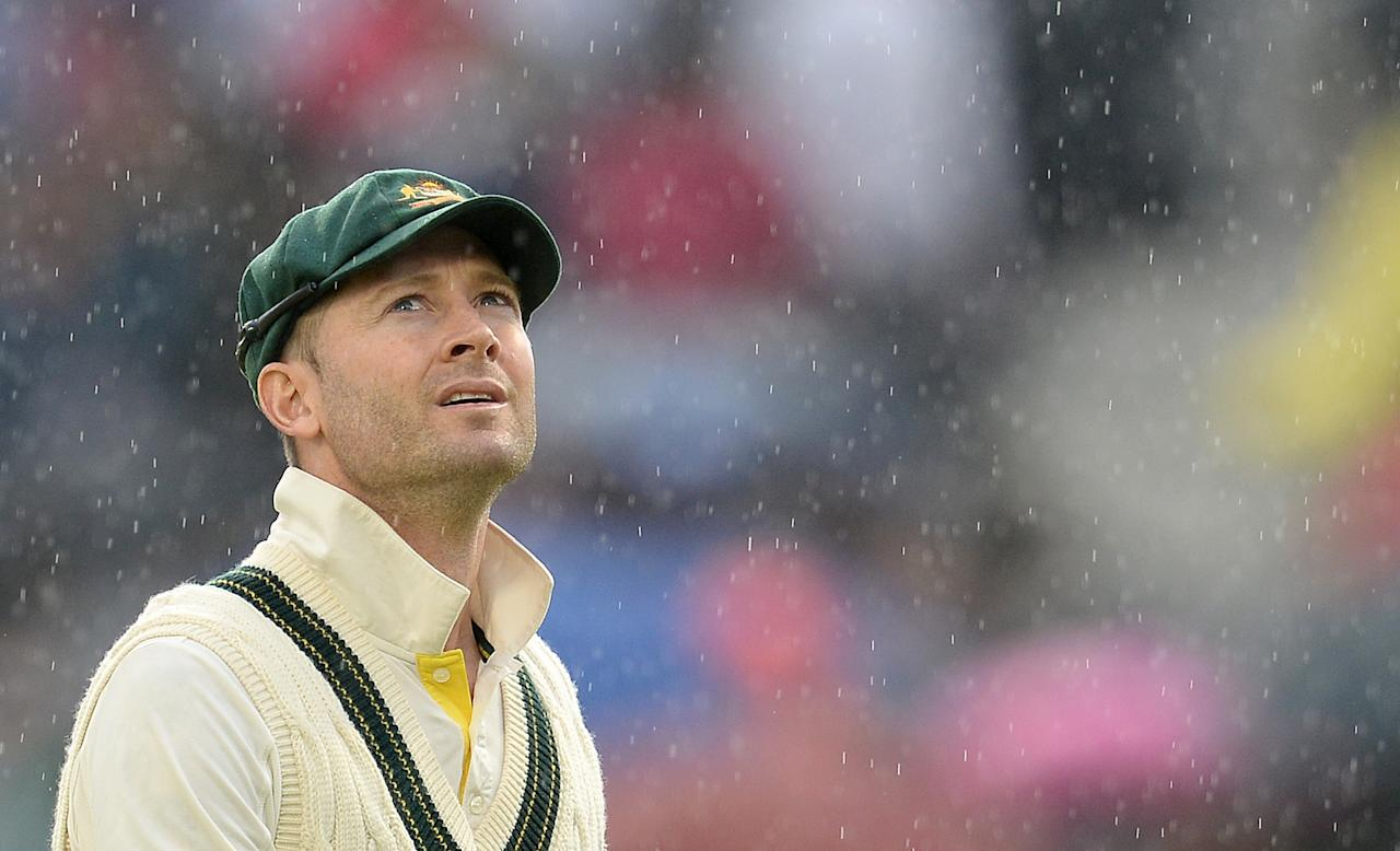 Australia's Michael Clarke looks to the sky as rain stops play during day five of the Third Investec Ashes test match at Old Trafford Cricket Ground, Manchester.