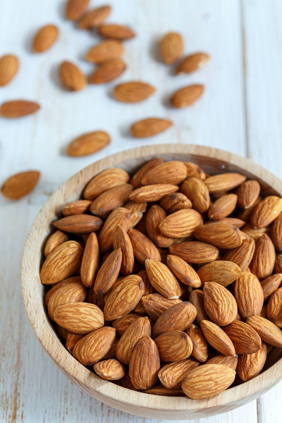 "<p>If you're on the hunt for a snack, <a href=""https://www.goodhousekeeping.com/health/diet-nutrition/a19503705/almonds-nutrition/"" rel=""nofollow noopener"" target=""_blank"" data-ylk=""slk:consider picking up some almonds"" class=""link rapid-noclick-resp"">consider picking up some almonds</a>. Population <a href=""https://www.ncbi.nlm.nih.gov/pubmed/27752301"" rel=""nofollow noopener"" target=""_blank"" data-ylk=""slk:studies"" class=""link rapid-noclick-resp"">studies</a> have shown that consistent intake of almonds reduces risk of heart disease <a href=""https://www.goodhousekeeping.com/health/diet-nutrition/a18527/high-blood-pressure-natural-remedies/"" rel=""nofollow noopener"" target=""_blank"" data-ylk=""slk:by improving cholesterol levels"" class=""link rapid-noclick-resp"">by improving cholesterol levels</a> — maintaining HDL and lowering LDL. </p>"
