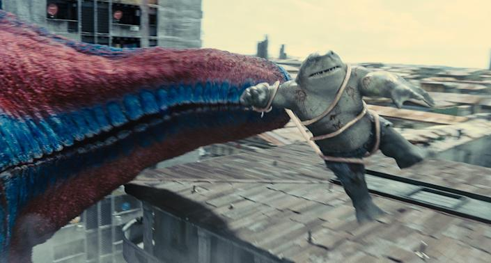 """King Shark (voiced by Sylvester Stallone) tussles with a giant starfish in """"The Suicide Squad."""""""