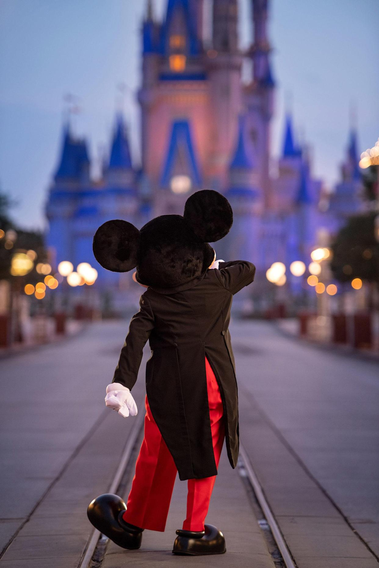 Disney World in Orlando, Fla., relaxed its face mask rules in specific outdoor areas of the park. (Photo: Kent Phillips/Walt Disney World Resort via Getty Images)