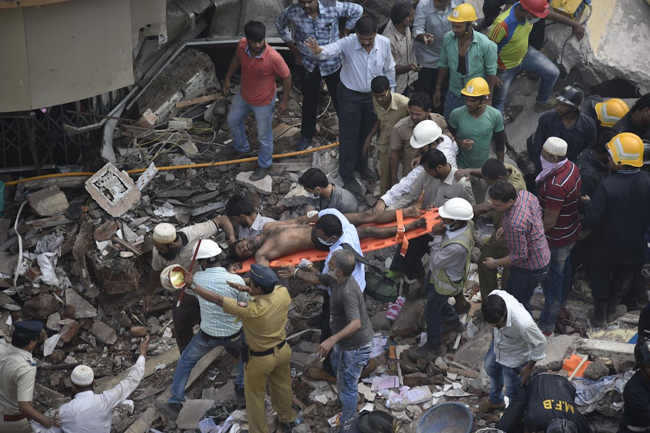 <p>Search and rescue works in progress after a five-story building collapsed in Mumbai, India, on Aug. 31, 2017. (Photo: Imtiyaz Shaikh/Anadolu Agency/Getty Images) </p>